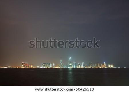 The night skyline over the persian gulf of the city of Doha, Qatar - stock photo