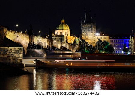 The night View on bright Prague Old Town with the Charles Bridge and its Bridge Tower, Czech Republic - stock photo