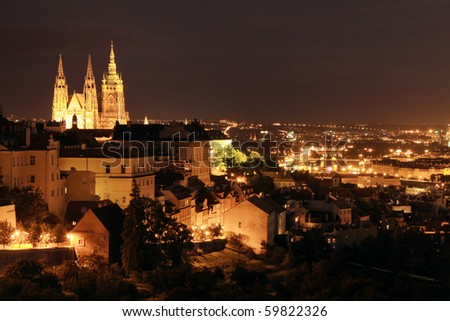 The night View on bright Prague with gothic Castle - stock photo
