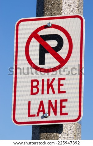 "The ""No Parking Bike Lane"" sign. - stock photo"