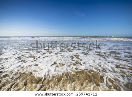 The North Sea with a blue sky - stock photo