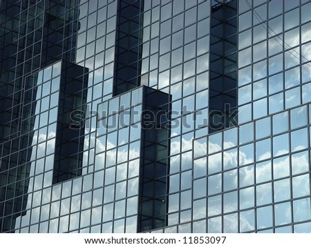 The Northern and Shell building by the side of the river Thames showing a reflection of the sky - stock photo