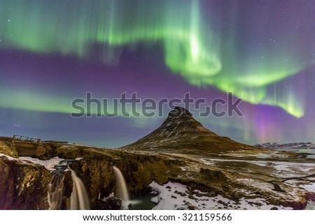 The Northern Light Aurora borealis at Kirkjufell Iceland - stock photo