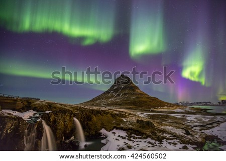 The Northern Lights Aurora borealis at Kirkjufell Iceland - stock photo