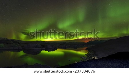 The Northern lights (Aurora borealis) reflection at Jokulsalon Glacier Lagoon, Iceland - stock photo