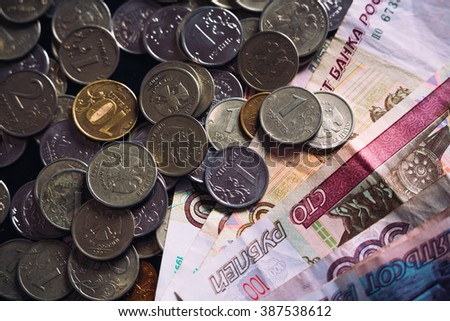 The note hundred rubles  and small coins  Russian money