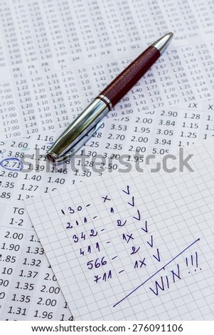 The note with the win selection of the winning codes on bookmakers - stock photo