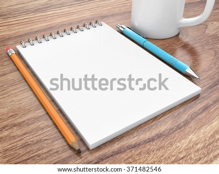 The notepad with the pen lies on a table - stock photo