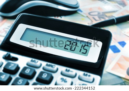 the number 2015, as the new year, on the display of a calculator - stock photo