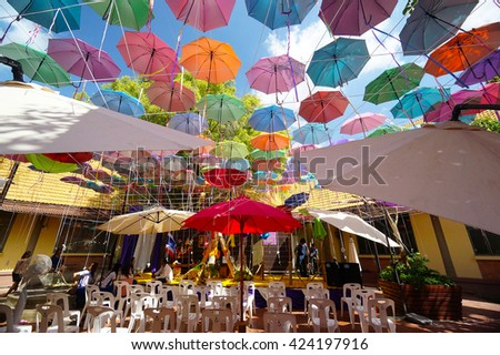 The number of multi-colored umbrellas in Thailand. - stock photo