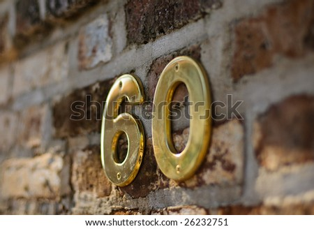 The number 60 on brick - stock photo