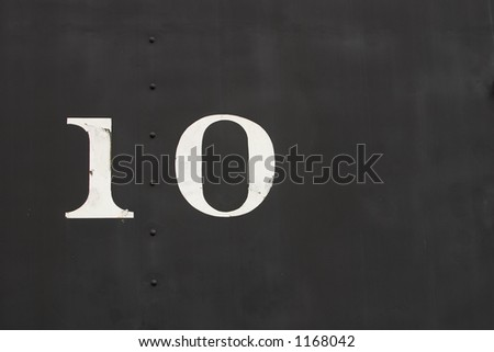 The number 10 painted on the side of an old locomotive train car - stock photo