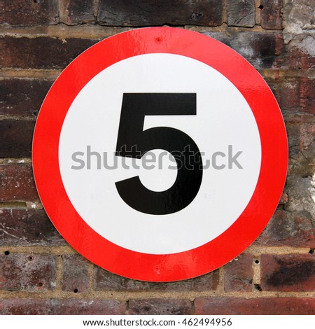 The number 5 seen on a road sign for speed limitation