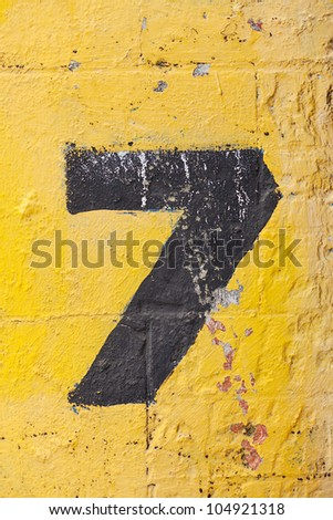 The number seven painted on a carpark wall