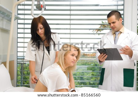 The nurse stethoscope examines a patient