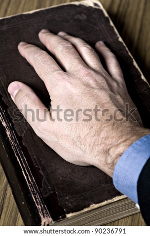 the oath with hand on the Holy Bible - stock photo