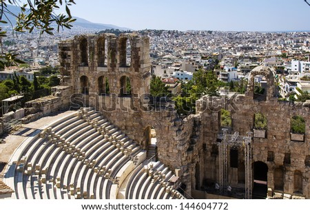 The Odeon of Herodes Atticus is a stone theatre structure located on the southwest slope of the Acropolis of Athens. - stock photo