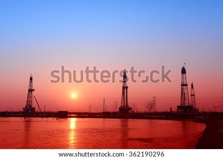 The oil derrick  - stock photo