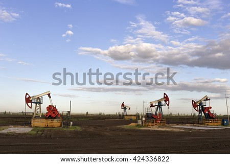 the oil pump is pumping. - stock photo