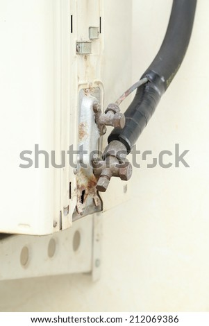 The old air conditioner drip valve - stock photo