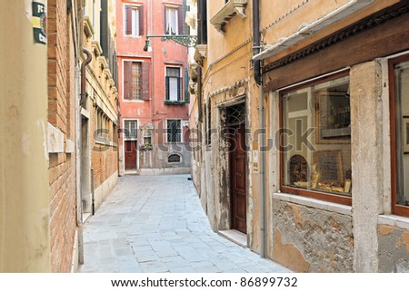 The old and narrow Venetian street. Italy.