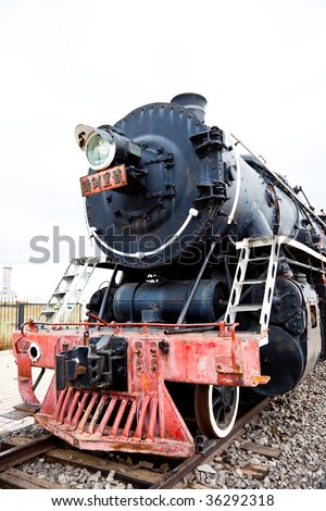 the old black locomotive of the train.