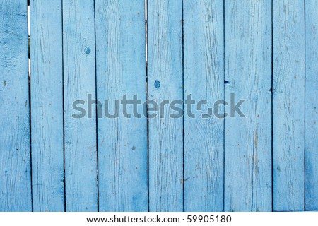 The old blue wooden creaked fence - stock photo