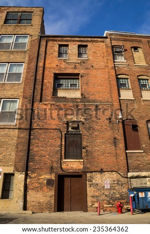 The old brick building in the Midwest suburb.   - stock photo