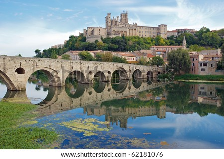 The Old Bridge and Saint Nazaire Cathedral at Beziers, France - stock photo