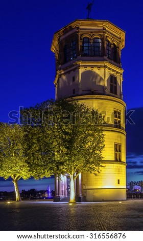 The old castle tower is the last remaining structure of the old palace of Dusseldorf which was destroyed by fire in 1882, Germany. Evening - stock photo