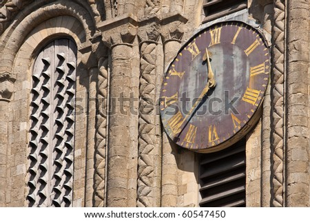 The old clock on the outside of Winchester cathedral - stock photo