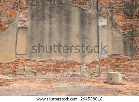 The old cracked wall of the abandoned ruins - stock photo