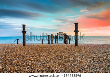 The old derelict West Pier in Brighton at sunset - stock photo