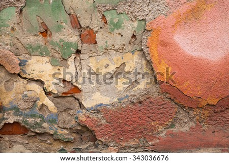 The old destroyed plaster on a wall - stock photo