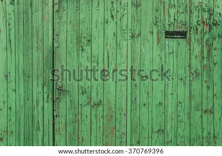 The old dilapidated window frame house green - stock photo