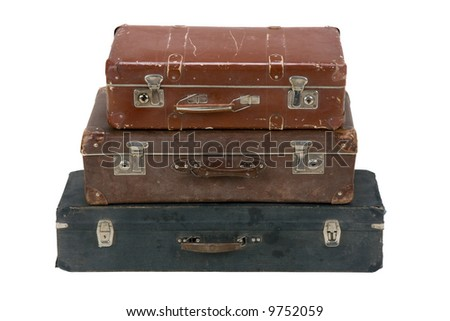 The old dirty, scratched suitcases located by a pyramid on a white background