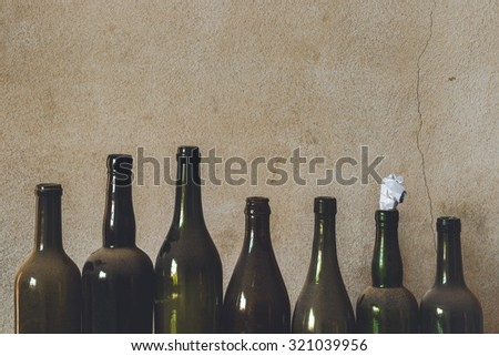 The old empty bottles of alcohol and beer - stock photo