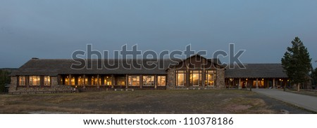 The Old Faithful Lodge in the evening in Yellowstone National Park, Wyoming - stock photo