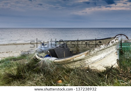 The old fishing boat at the early morning, Baltic Sea, Latvia, Europe - stock photo