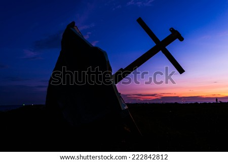 The old fishing boat over a sunset or sunrise sky - stock photo