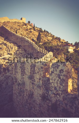 The old fortress and Mediterranean sea in Alanya, Turkey. Filtered image:cross processed vintage effect.  - stock photo