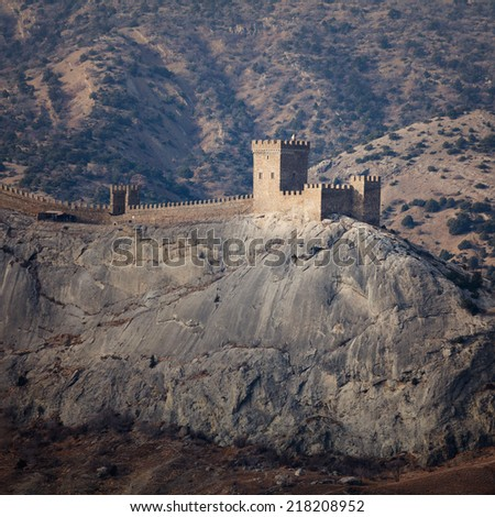 The old Genoese fortress is constructed on rocky breakage among mountains. - stock photo