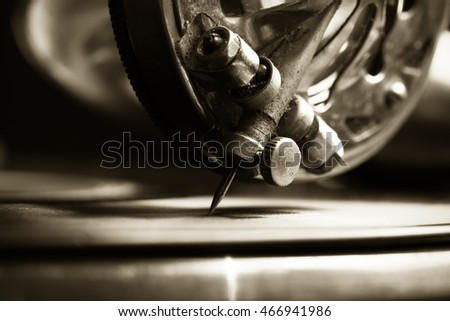 The old gramophone. Close up view. Selective focus. Shallow depth of field. Toned.