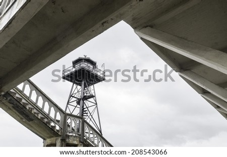 The old Guard Tower on Alcatraz Penitentiary island, now a museum, in San Francisco, California, USA. A view of the watchtower and a staircase leading to the barracks, Building 64. - stock photo