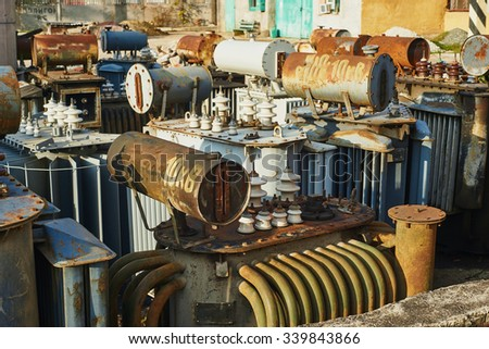 The old high-voltage substation equipment - stock photo