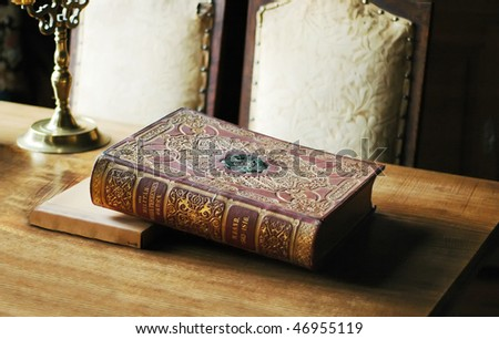 The old history book on the table - stock photo