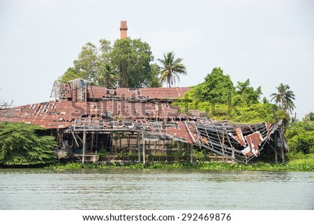 The old house construction fail at edge of the river - stock photo