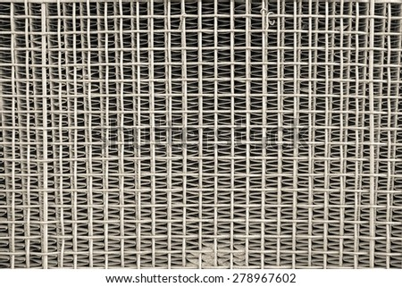 the old iron lattice protects a car radiator, the textured abstract background of beige color - stock photo