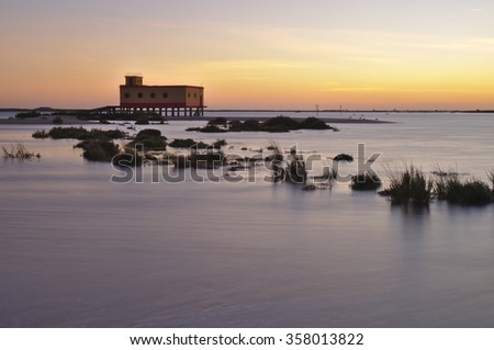 The old landmark building of the lifesavers during twilight in Fuzeta, Algarve, Portugal. Long exposure shot - stock photo