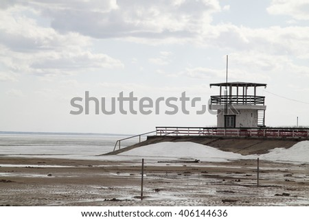 the old lifeboat station on the beach - stock photo